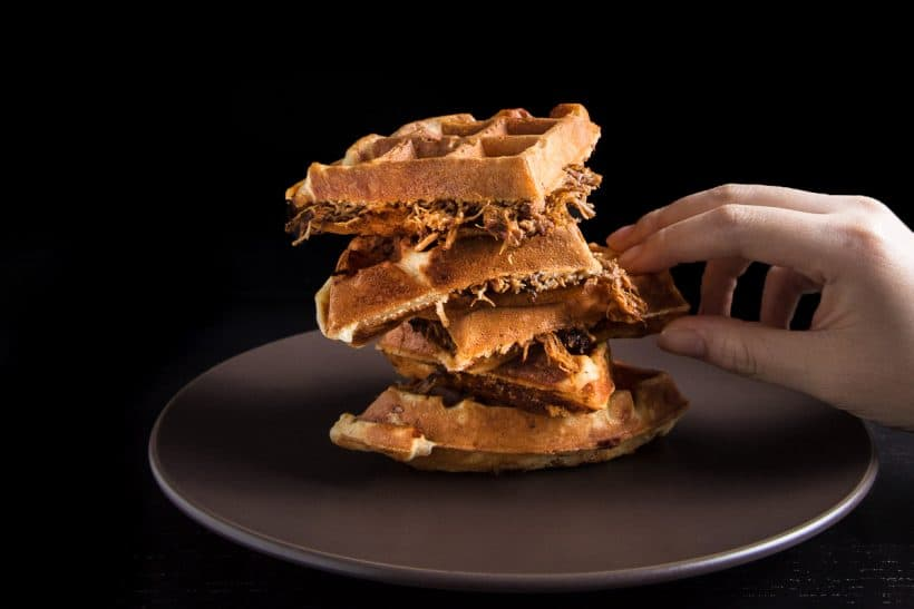 Got leftover pulled pork? Make this BBQ Pulled Pork Savory Waffles Recipe! Crisp, fluffy waffles with flavorful pulled pork. Delicious till very last bite!