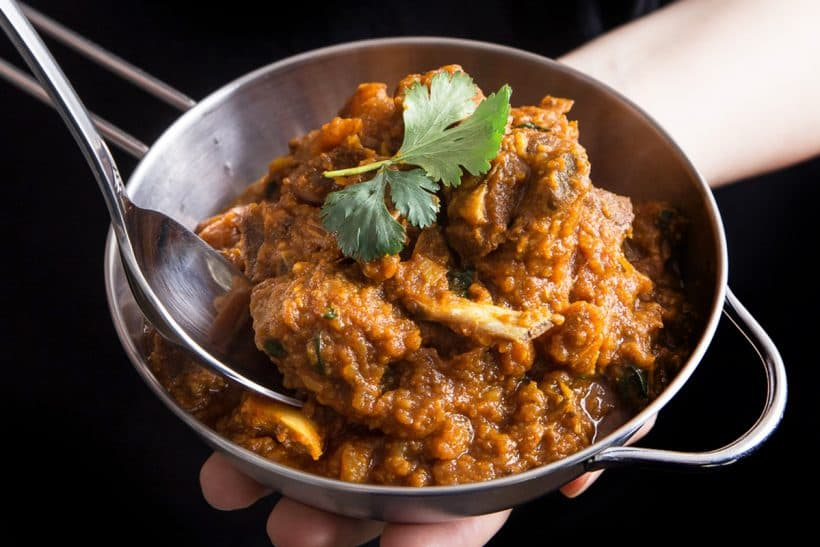 Make this Pressure Cooker Curry Goat Recipe to cook super tender & moist goat meat. You'll love the thick curry exploding with depths of fragrances & flavors!