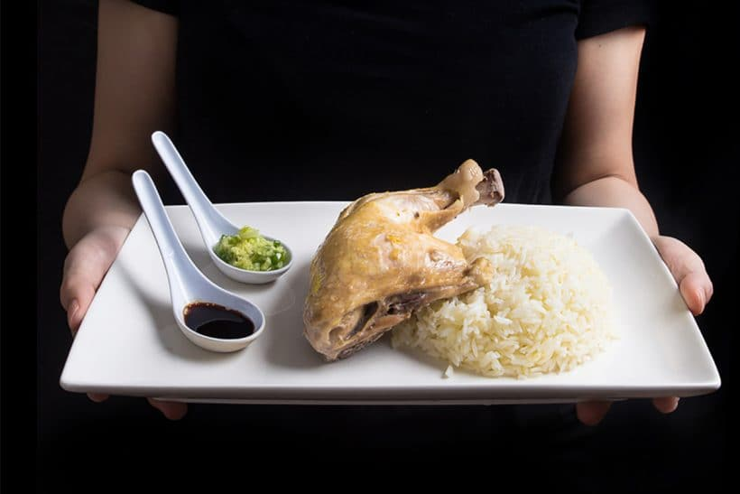 "Make this easy Singaporean Hainanese Chicken Rice recipe! Dip the tender & moist Hainanese chicken into flavorful sauces with a spoonful of fragrant ""oily rice"". Comforting chicken and rice meal with a homey soup. A simple complete meal with almost zero waste!"