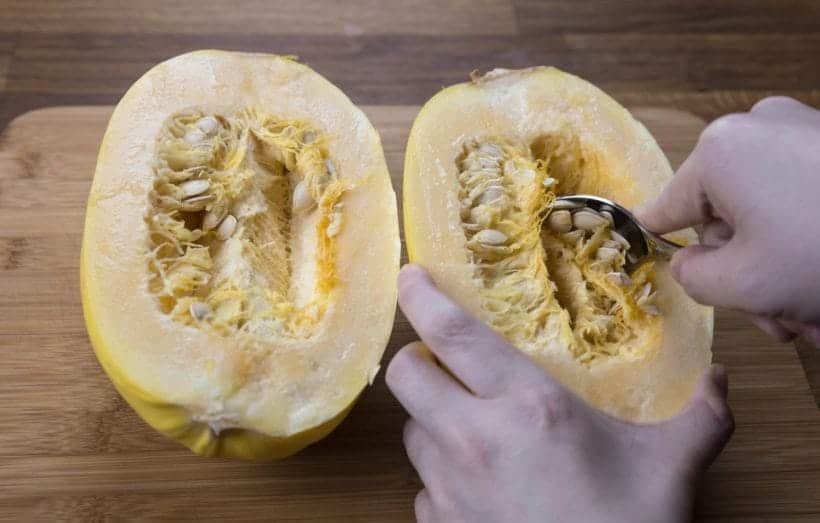 How to prepare spaghetti squash - scraping the seeds   #AmyJacky #InstantPot #PressureCooker #recipe #vegan #GlutenFree #LowCarb #healthy