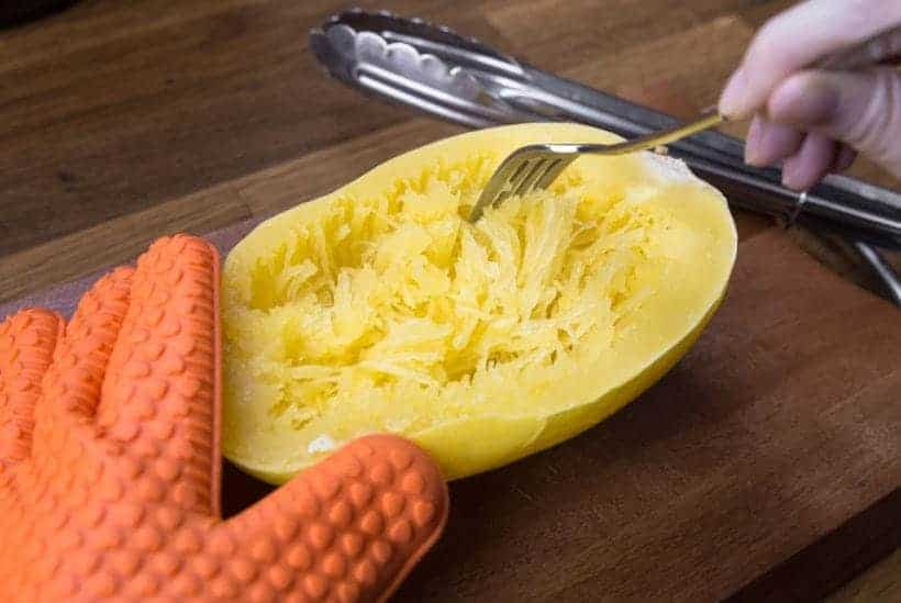 "Rake the flesh away from the skin with a fork to create long ""spaghetti-like"" strands."
