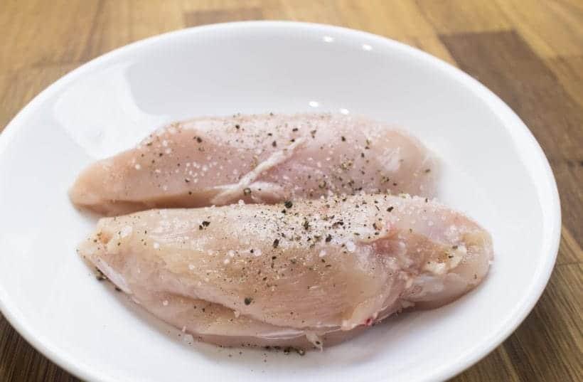 Instant Pot Spinach Chicken Alfredo Pasta Recipe: Season chicken breasts with kosher salt and ground black pepper.