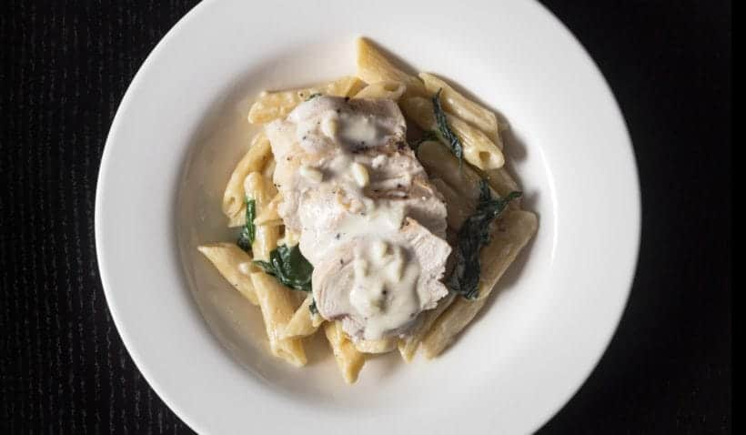 Instant Pot Spinach Chicken Alfredo Pasta Recipe with homemade Alfredo sauce! Kid-friendly pressure cooker pasta for busy weeknights.