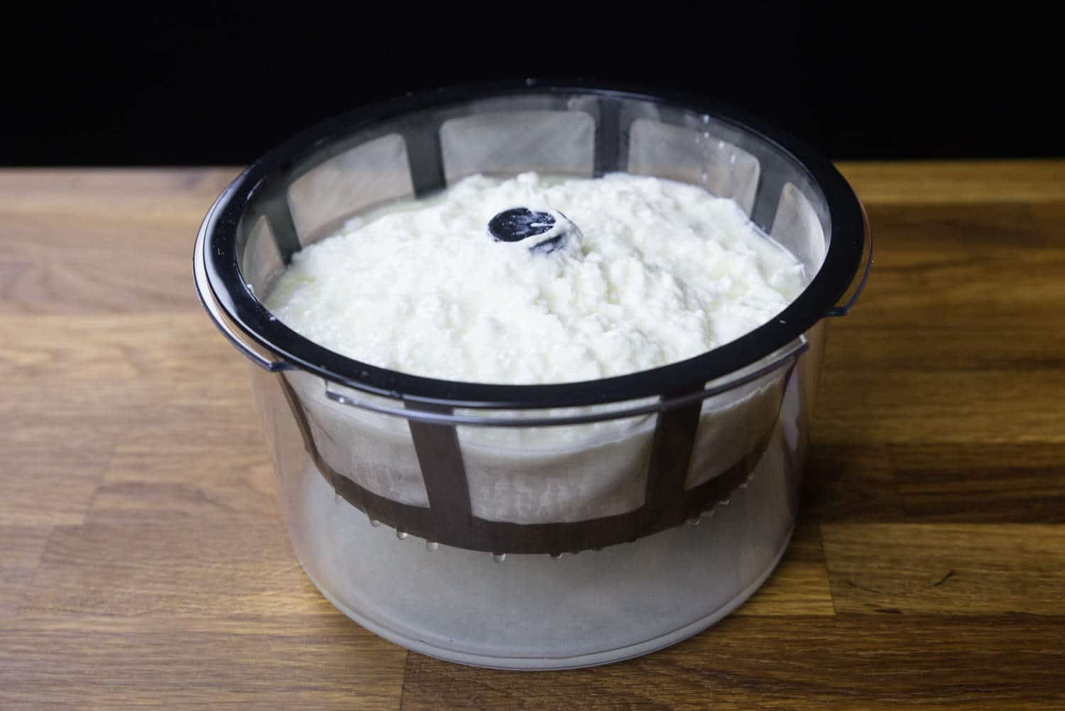 Foolproof Instant Pot Greek Yogurt Recipe #12 (Pressure Cooker Greek Yogurt): straining the yogurt with Greek Yogurt Maker to separate the whey from the yogurt