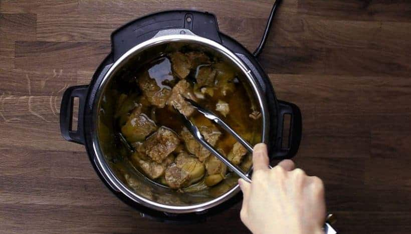 Easy Instant Pot Carnitas Recipe (Pressure Cooker Carnitas): remove pressure cooked pork shoulder from Instant Pot Ultra