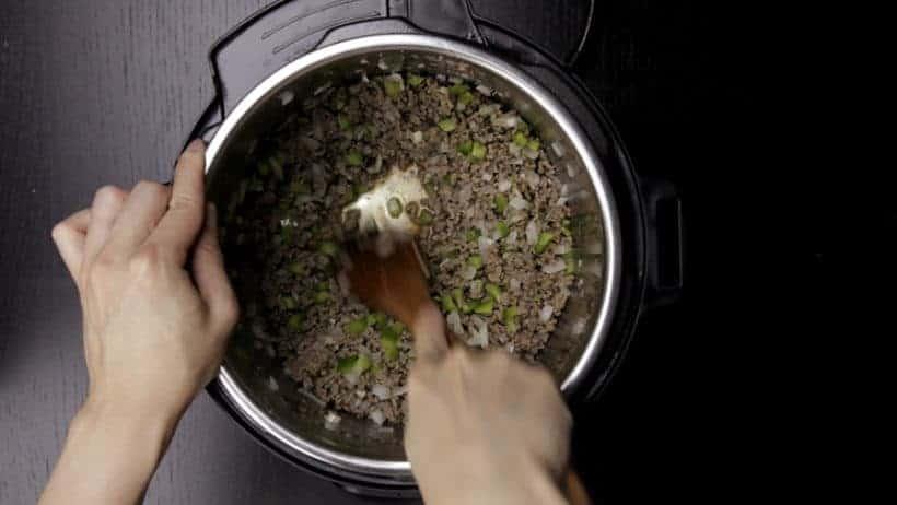 Make Family Favorite Instant Pot Sloppy Joes Recipe (Pressure Cooker Sloppy Joes): deglaze ground beef with wooden spoon