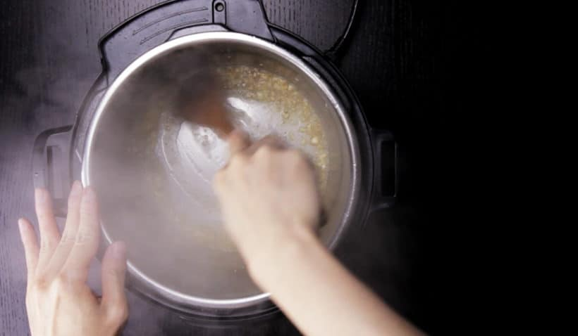 Instant Pot Lemon Chicken Recipe (Pressure Cooker Lemon Chicken): deglaze pot with shaoxing wine and wooden spoon