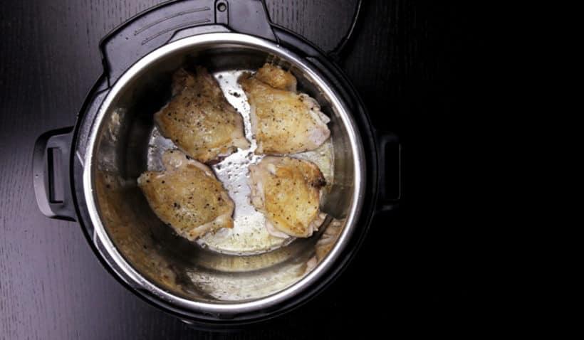 Instant Pot Lemon Chicken Recipe (Pressure Cooker Lemon Chicken): season and brown chicken thighs in Instant Pot Electric Pressure Cooker