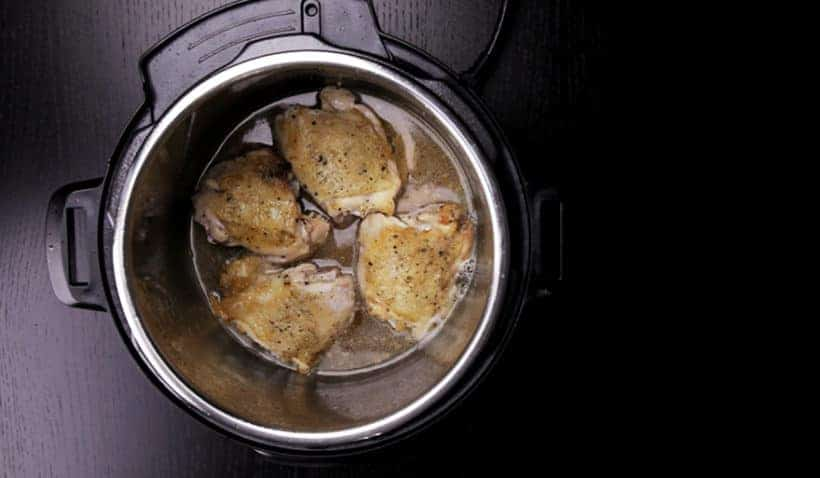 Instant Pot Lemon Chicken Recipe (Pressure Cooker Lemon Chicken): place seasoned and browned Instant Pot Chicken Thighs in the lemon garlic sauce for pressure cooking