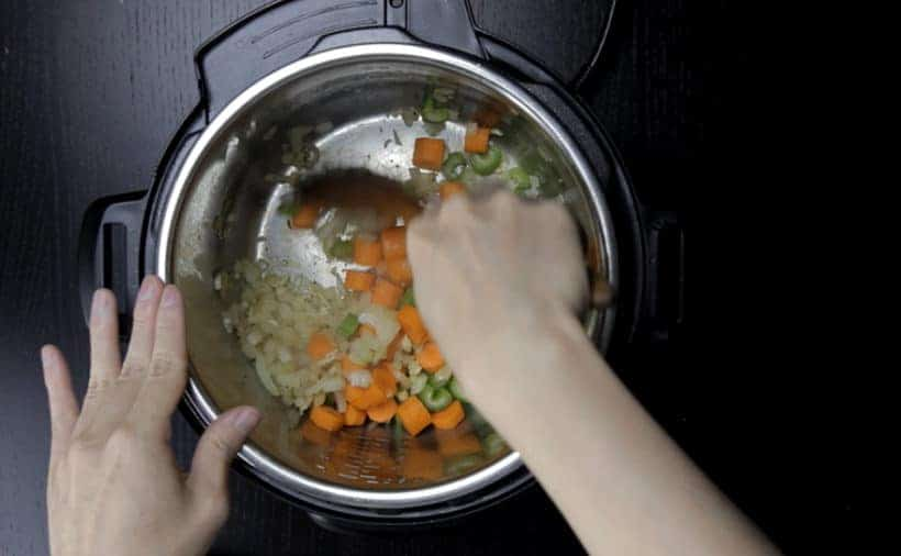 Instant Pot Chicken Breast Recipe (Pressure Cooker Chicken Breast): saute diced onion, minced garlic, chopped celery, chopped carrots in Instant Pot Multicooker until fragrant and lightly browned.