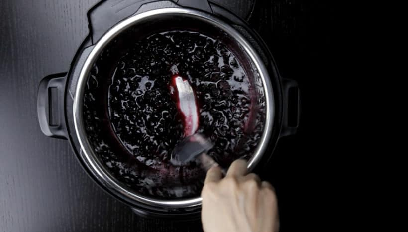 How to make Instant Pot Blueberry Compote Recipe (Pressure Cooker Blueberry Compote): stir, smash, add remaining blueberries, add sweetener, stir to thicken.