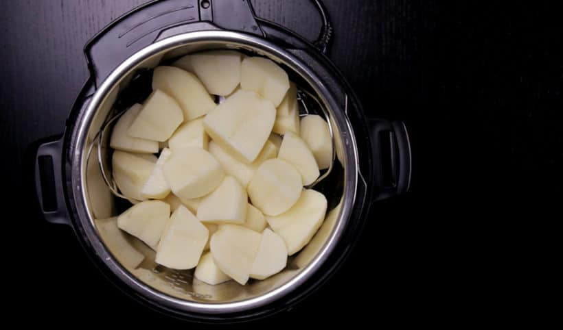 Michelin-Star Inspired Instant Pot Mashed Potatoes Recipe: add quartered potatoes on steamer rack trivet in Instant Pot Electric Pressure Cooker