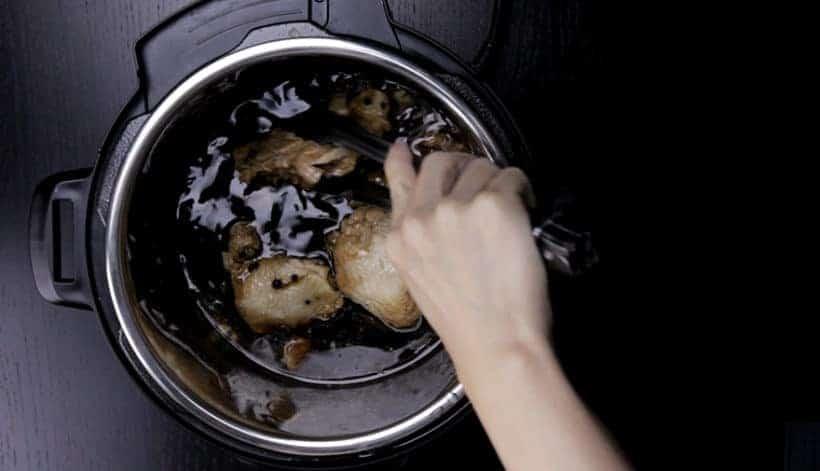 Instant Pot Chicken Adobo Recipe (Pressure Cooker Chicken Adobo): remove pressure cooked chicken and thicken adobo sauce