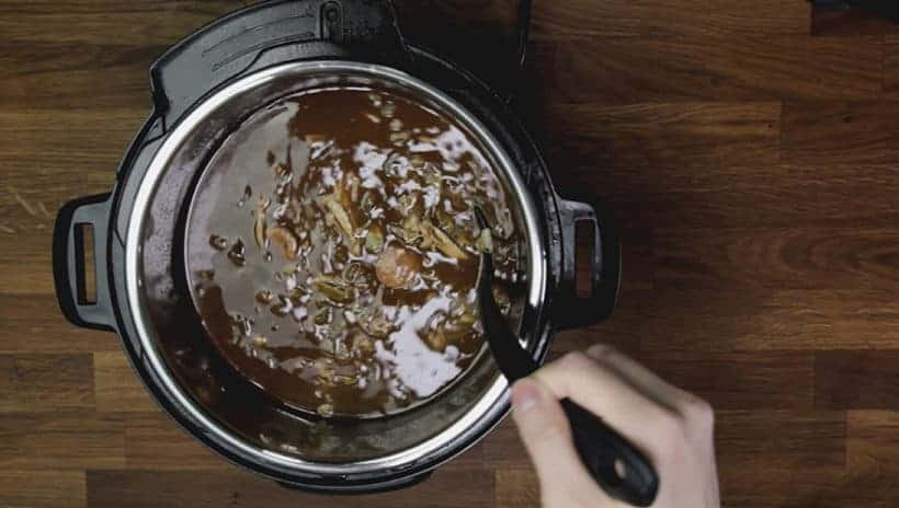 Instant Pot Gumbo Recipe (Pressure Cooker Gumbo): add shredded chicken thighs into gumbo in Instant Pot Electric Pressure Cooker. Taste and adjust seasoning.