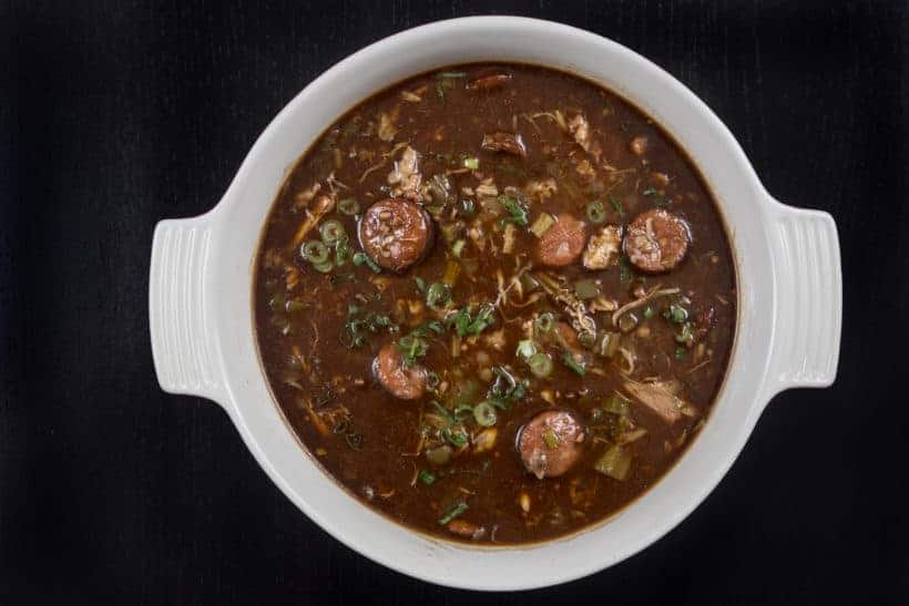 Make Mouthwatering Louisiana Instant Pot Gumbo Recipe (Pressure Cooker Gumbo): a hearty Southern pot of love packed with smoky-spicy Cajun, Creole flavors and rich aromas. Feed your crowd with this delicious party favorite - not just for Mardi Gras! #instantpot #instantpotrecipes #gumbo #pressurecooker #pressurecookerrecipes