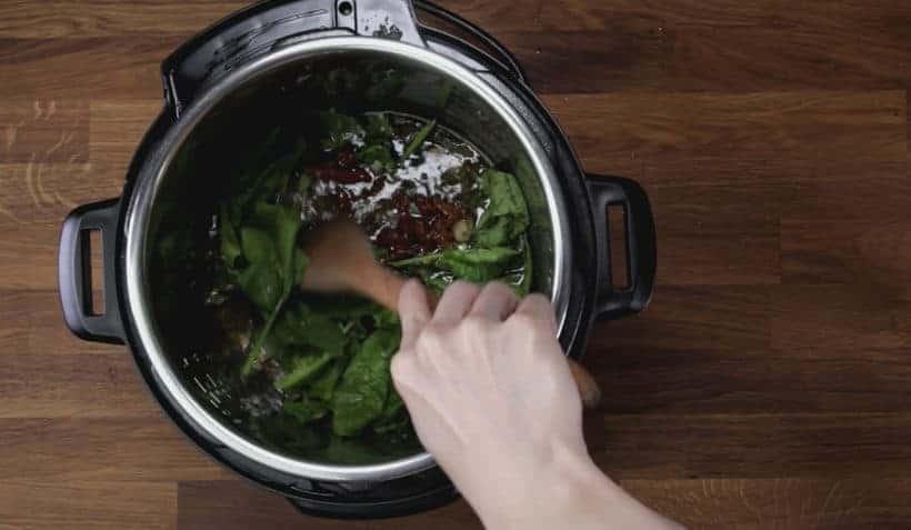 Instant Pot Tuscan Chicken Recipe (Pressure Cooker Tuscan Garlic Chicken): add spinach and sun-dried tomatoes in Instant Pot Pressure Cooker