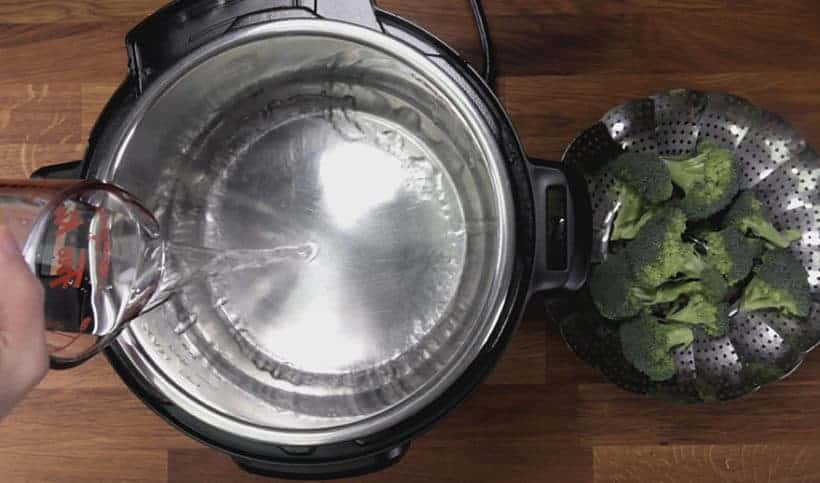 Instant Pot Broccoli Recipe: add water in Instant Pot #instantpot #pressurecooker #vegan #vegetarian #recipe #keto #paleo