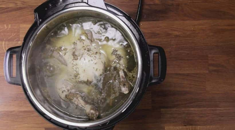 Instant Pot Chicken | Instant Pot Whole Chicken | Instant Pot Roast Chicken: remove and drain pressure cooked whole chicken from Instant Pot Pressure Cooker