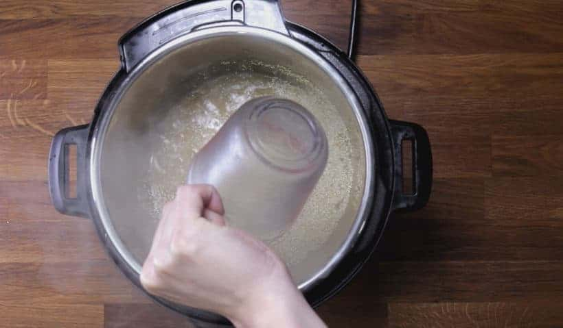 Instant Pot Quinoa Recipe: deglaze Instant Pot Pressure Cooker by scrubbing bottom of inner pot with wooden spoon