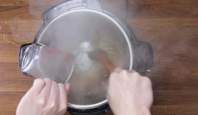 Instant Pot Pork Tenderloin: deglaze Instant Pot Pressure Cooker inner pot with wooden spoon