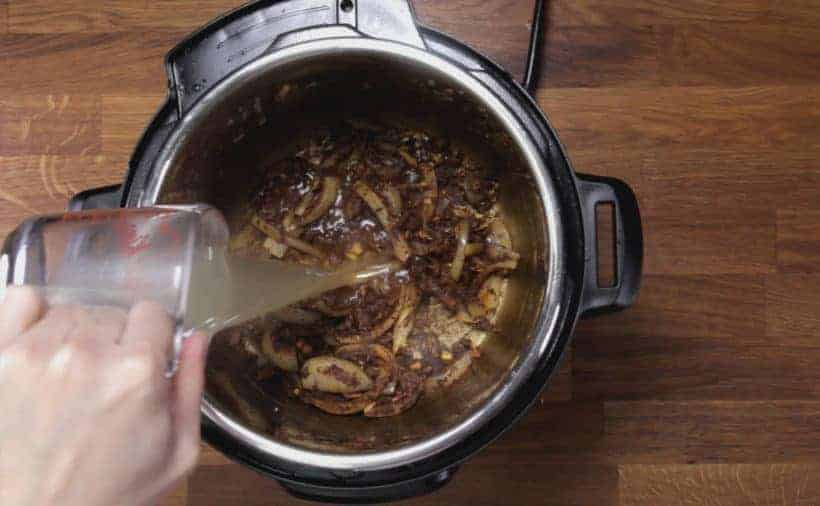 Instant Pot Butter Chicken: deglaze Instant Pot Pressure Cooker inner pot