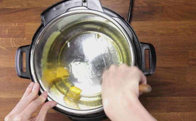 Instant Pot Butter Chicken: add ghee in Instant Pot Pressure Cooker