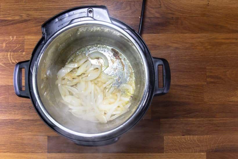 Instant Pot Butter Chicken: saute onions in Instant Pot Pressure Cooker