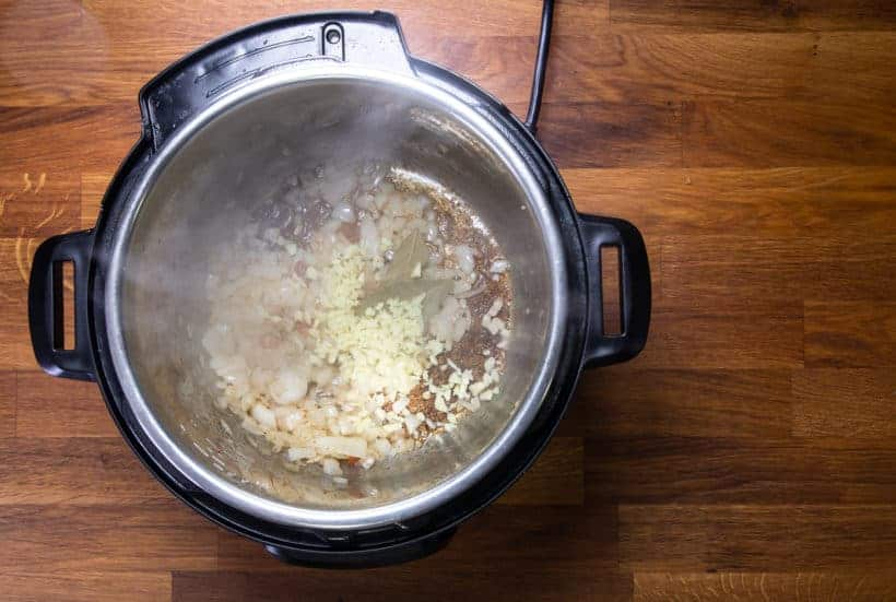 Instant Pot Potato Soup: saute onions and garlic in Instant Pot Pressure Cooker
