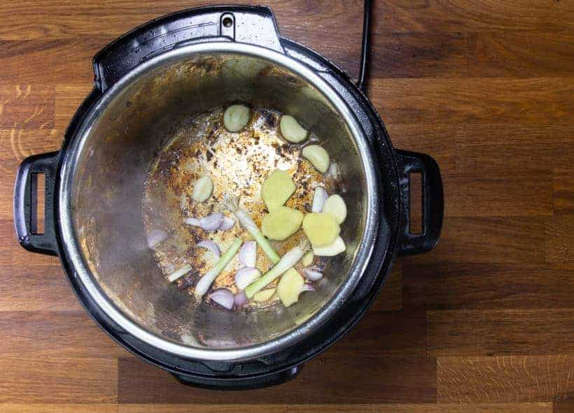 Instant Pot Chinese Beef Stew: saute garlic, ginger, shallot, green onions in Instant Pot Pressure Cooker
