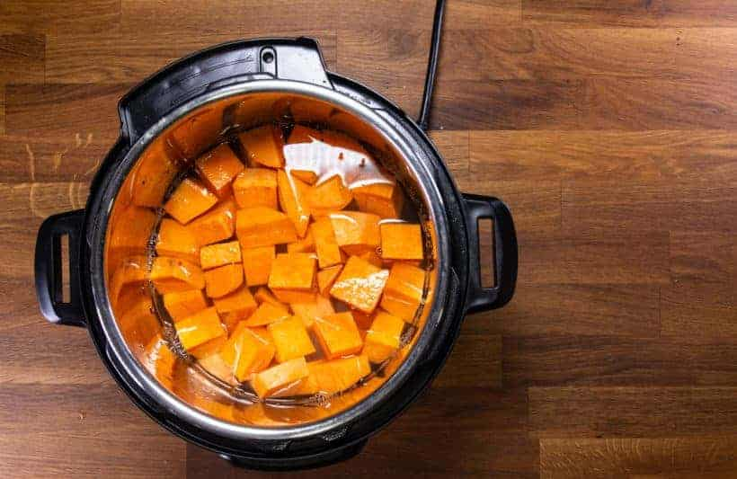 Instant Pot Chinese Sweet Potato Soup: add sweet potato chunks and water in Instant Pot Pressure Cooker